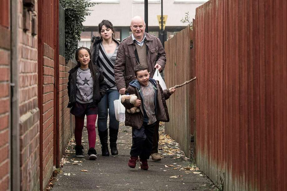 """Dan (Dave Johns) navigates government assistance bureaucracy with single mom Katie (Hayley Squires) and kids Daisy (Briana Shann) and Dylan (Dylan McKiernan) in """"I, Daniel Blake."""" Photo: Joss Barratt, Sundance Selects"""