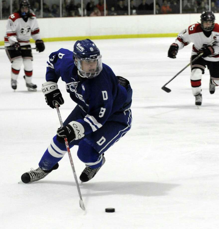 Darien's Arden Cohen takes the puck in a FCIAC boys varsity ice hockey game against New Canaan at the Darien Ice Rink on Dec. 27, 2016. New Canaan defeated Darien 5-2. Photo: Matthew Brown / Hearst Connecticut Media / Stamford Advocate