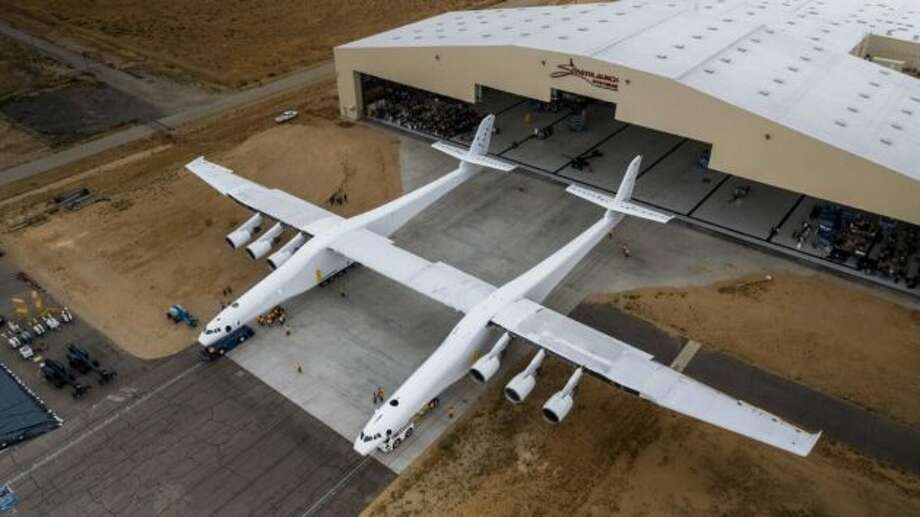 An aerial view shows the Stratolaunch airplane outside its hangar for the first time. The twin-fuselage aircraft is the world's largest airplane, measured by wingspan. (Stratolaunch Photo)