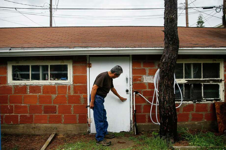 In a Monday, May 22, 2017 photo, Lalo Ojeda points at the water line on his garage from Hurricane Ike in Galveston, Texas.  Ojeda is watching the Atlantic hurricane season that begins Thursday with more concern than usual. The retired Coast Guard employee worries that rising sea levels could make the next hurricane more destructive than those he's lived through. ( Michael Ciaglo/Houston Chronicle via AP) Photo: Michael Ciaglo, MBO / Michael Ciaglo