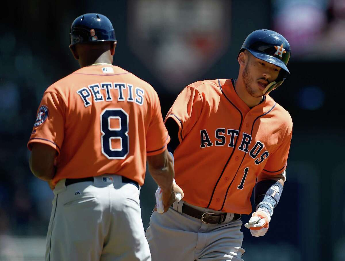 MINNEAPOLIS, MN - MAY 31: Third base coach Gary Pettis #8 of the Houston Astros congratulates Carlos Correa #1 on a two-run home run against the Minnesota Twins during the first inning of the game on May 31, 2017 at Target Field in Minneapolis, Minnesota.