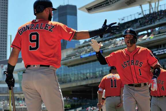 MINNEAPOLIS, MN - MAY 31: Marwin Gonzalez #9 of the Houston Astros congratulates teammate Carlos Correa #1 of the Houston Astros on a two-run home run against the Minnesota Twins during the first inning of the game on May 31, 2017 at Target Field in Minneapolis, Minnesota.