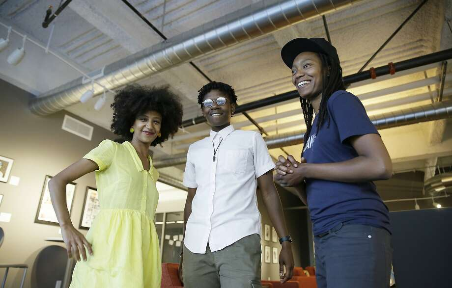 In this May 2, 2017, photo, Ebele Ifedigbo, center, co-director, Lanese Martin, right, co-director and Biseat Horning, left, 32, fellow, pose at the offices of The Hood Incubator in Oakland. Photo: Eric Risberg, Associated Press