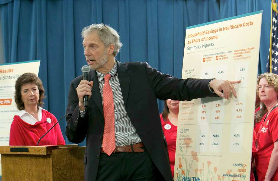 Professor Robert Pollin, a researcher from the University of Massachussetts-Amherst, gestures to a chart showing estimates of cost savings if a proposed single-payer health care bill was approved by the Legislature, during a news conference, Wednesday, May 31, 2017,in Sacramento, Calif. A report released by the California Nurses Association, done by Pollin and others, suggests that a 2.3 precent sales tax and a 2.3 precent gross receipts tax would help cover the additional costs to provide health care for all Californians. Photo: Rich Pedroncelli, AP / Copyright 2017 The Associated Press. All rights reserved.