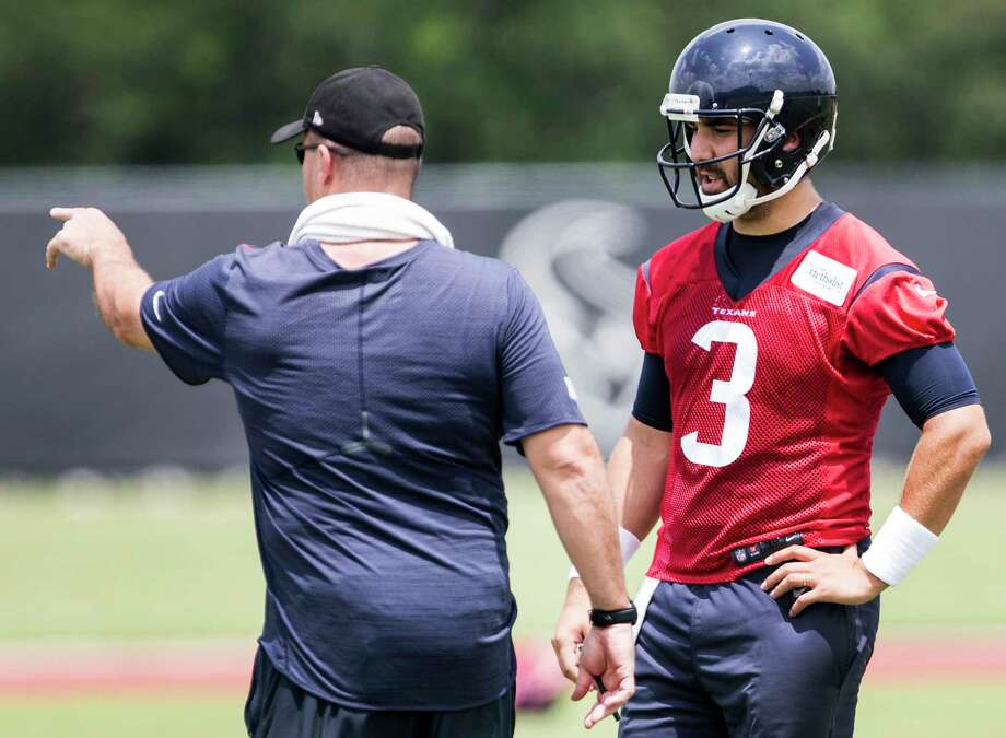 Houston Texans head coach Bill O'Brien, left, works with quarterback Tom Savage (3) during OTAs at The Methodist Training Center on Wednesday, May 31, 2017, in Houston. Photo: Brett Coomer, Houston Chronicle / © 2017 Houston Chronicle