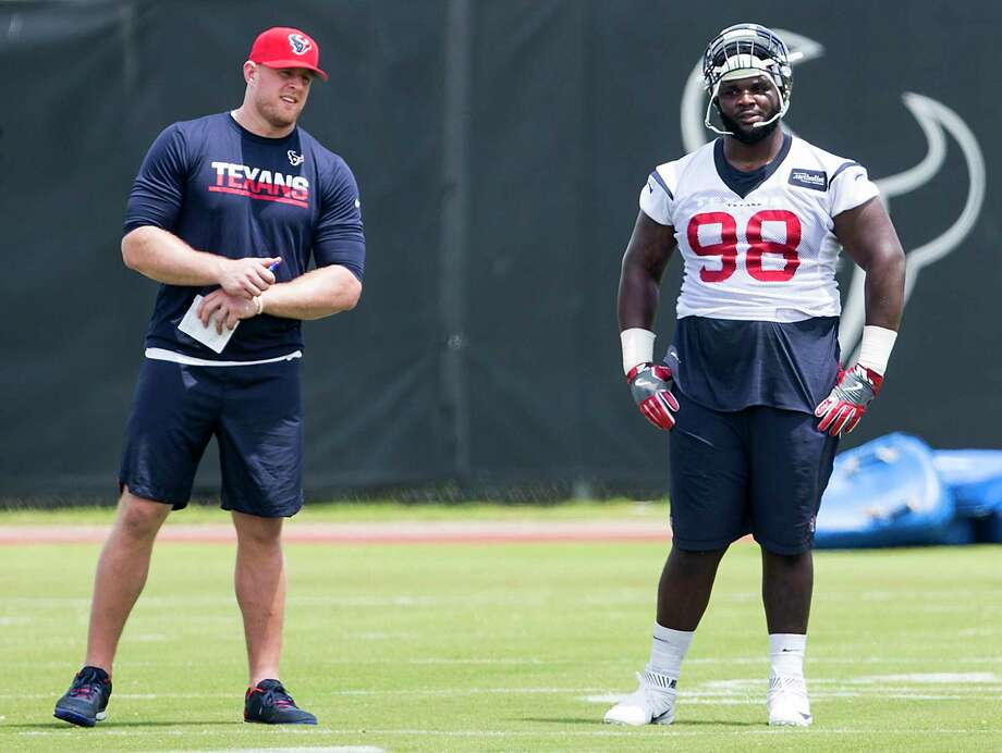 Houston Texans defensive end J.J. Watt, left, and nose tackle D.J. Reader (98) stand on the field during OTAs at The Methodist Training Center on Wednesday, May 31, 2017, in Houston. Photo: Brett Coomer, Houston Chronicle / © 2017 Houston Chronicle