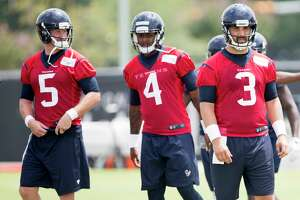 Houston Texans quarterback Brandon Weeden (5), Deshaun Watson (4) and Tom Savage (3) warm up during OTAs at The Methodist Training Center on Wednesday, May 31, 2017, in Houston.