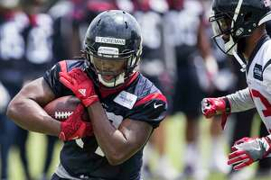 Houston Texans running back D'Onta Foreman (27) runs upfield after making a catch during OTAs at The Methodist Training Center on Wednesday, May 31, 2017, in Houston.