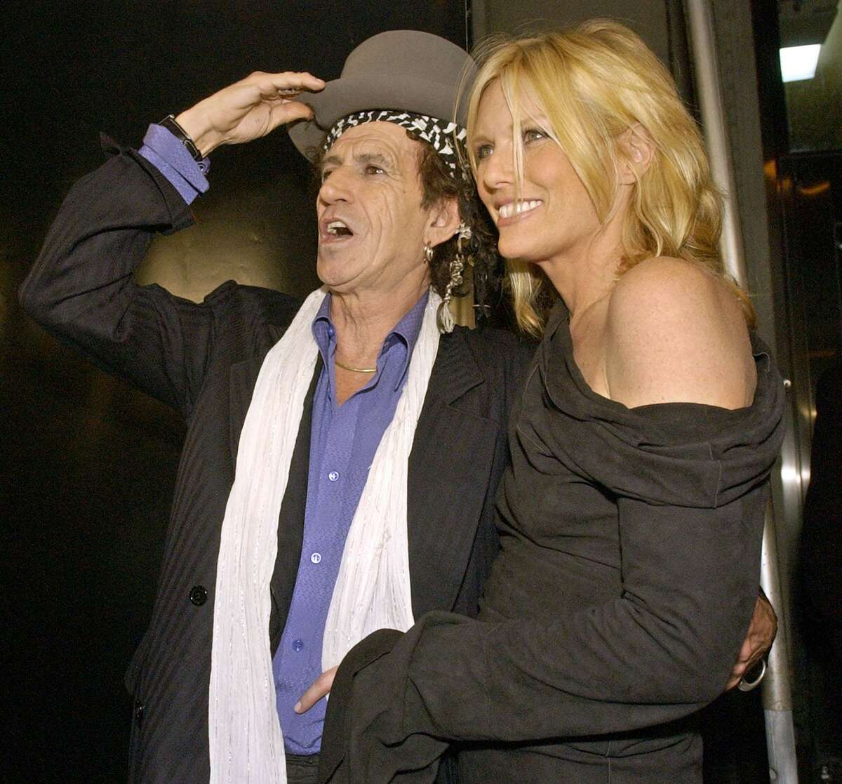 Rolling Stones' guitarist Keith Richards, left, arrives with his wife Patti Hansen at the launch party of the four DVD collection