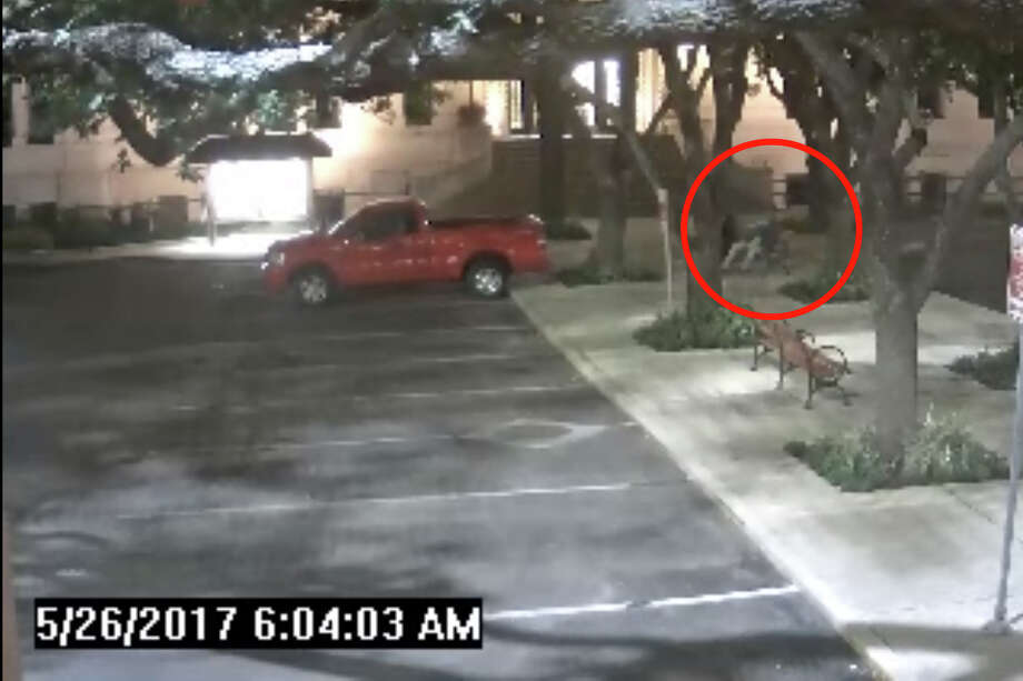 Surveillance footage shows San Antonio District 2 Councilman Alan Warrick sleeping on a bench outside of city hall on May 26, 2017, after a night of drinking. Photo: Screengrab/City Of San Antonio