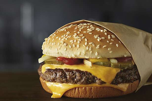This image provided by McDonald's Corporation shows a Quarter Pounder burger. McDonald's says it will swap frozen beef patties for fresh ones in its Quarter Pounder burgers by sometime in 2018 at most of its U.S. locations. Employees will cook up the never-frozen beef on a grill when ordered. (Courtesy of McDonald's Corporation via AP)