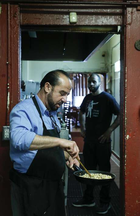 Old Jerusalem co-owner Ahmad Nasser works in the kitchen. Photo: Russell Yip, The Chronicle
