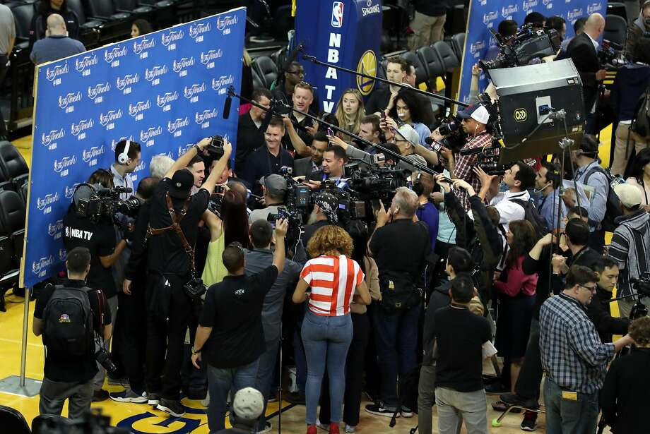 Golden State's Klay Thompson is surrounded by members of the media during Wednesday's gathering at Oracle Arena. Photo: Scott Strazzante, The Chronicle