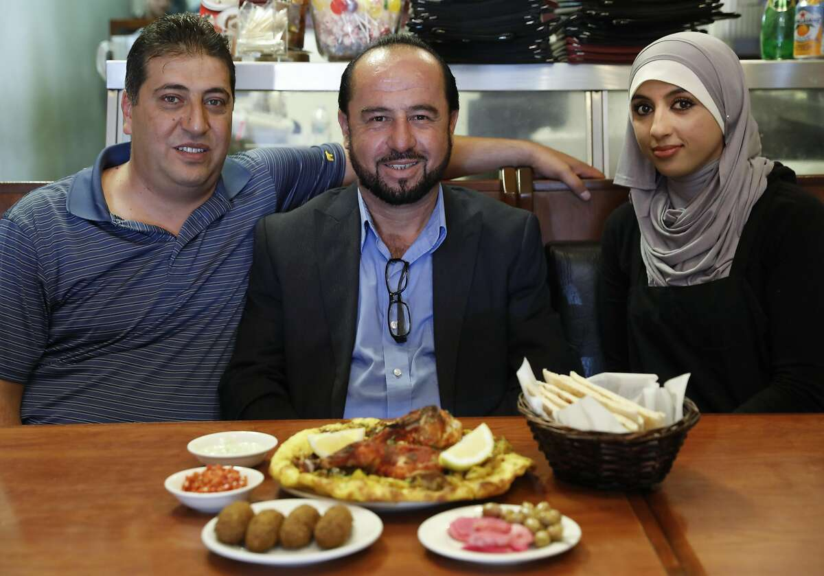 Co-owners Hajem Almukdad and Ahmad Nasser and chef Tahani Mohammad are seen at their restaurant Old Jerusalem Restaurant on Tuesday, May 23, 2017 in San Francisco, Calif.