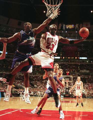 4fdd7e8ea307 The Chicago Bulls  Michael Jordan (23) goes up and under Utah Jazz forward