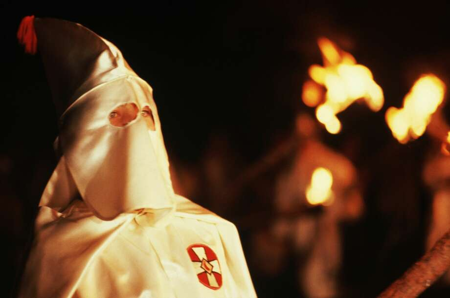 Texas City police have opened an investigation after 17 KKK recruitment flyers were thrown on lawns in one neighborhood. Photo: Leif Skoogfors/Getty Images