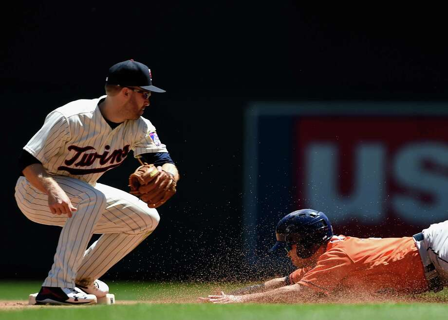 MINNEAPOLIS, MN - MAY 31: Norichika Aoki #3 of the Houston Astros steals second base against Brian Dozier #2 of the Minnesota Twins during the fourth inning of the game on May 31, 2017 at Target Field in Minneapolis, Minnesota. The Astros defeated the Twins 17-6. Photo: Hannah Foslien, Getty Images / 2017 Getty Images