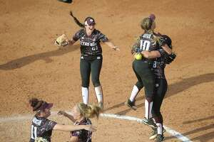 Texas A&M's Trinity Harrington (11), Ashley Walters (13, Kaitlyn Alderink (21) Riley Sartain (10) and Tori Vidales (8) celebrate after the final out in game 3 of the NCAA Super Regional softball game Sunday, May 28, 2017, in Knoxville, Tenn. (Scott Keller/The Daily Times via AP)
