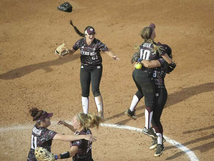 Texas A&M's Trinity Harrington (11), former Center Point standout Ashley Walters (13), Kaitlyn Alderink (21) Riley Sartain (10) and Tori Vidales (8) celebrate after the final out in Game 3 of the NCAA super regional win over Tennessee on May 28, 2017, in Knoxville.