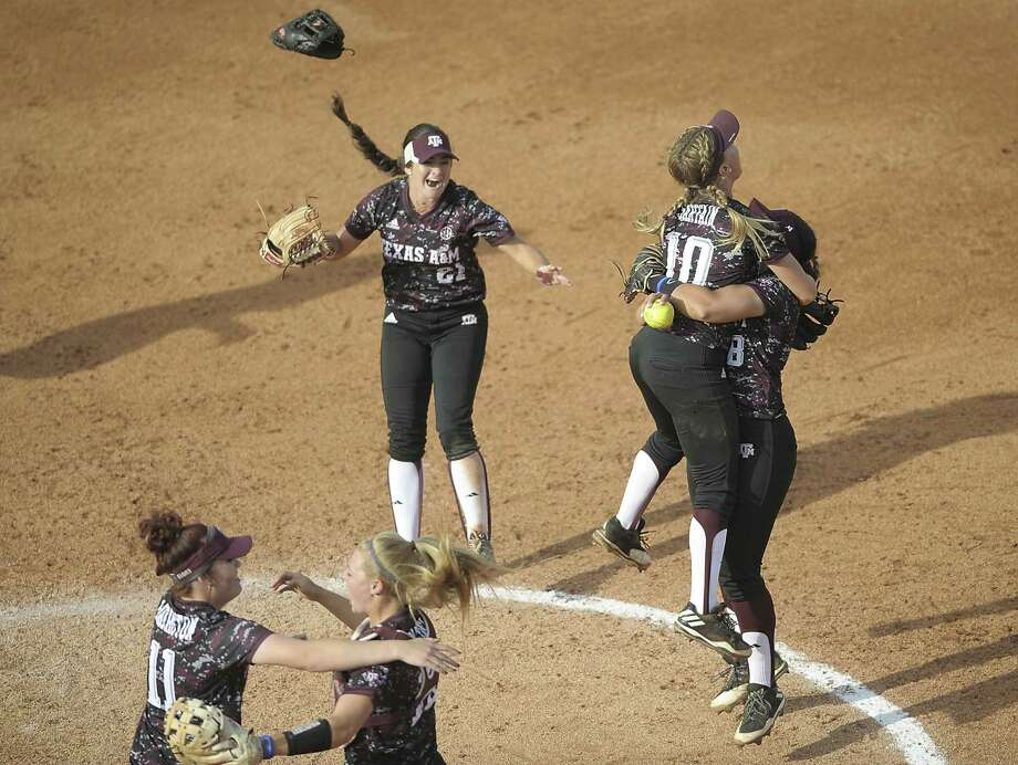 Texas A&M's Trinity Harrington (11), former Center Point standout Ashley Walters (13), Kaitlyn Alderink (21) Riley Sartain (10) and Tori Vidales (8) celebrate after the final out in Game 3 of the NCAA super regional win over Tennessee on May 28, 2017, in Knoxville. Photo: Scott Keller /Associated Press / The Daily Times