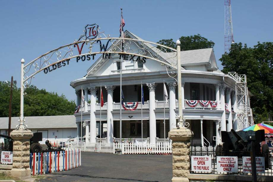 VFW Post 76 is headquartered in a Victorian-style house that features impressive Corinthian columns, a wide, wrap-around veranda, and both a basement and attic. At one time, according to the post website, the home had 17 rooms, five fireplaces, two kitchens and several handsome stained glass windows, at least three of which exist to this day. Photo: Express-News File Photo / JBEAL@EXPRESS-NEWS.NET