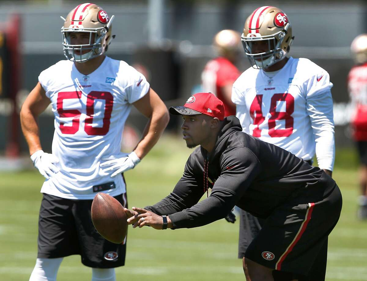 Defensive quality control coach DeMeco Ryans works with the linebackers including Brock Coyle (50) and Donavin Newsom (48) during a San Francisco 49ers team practice in Santa Clara, Calif. on Wednesday, May 31, 2017.