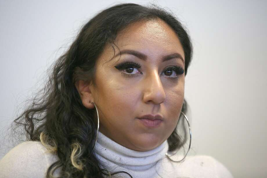 A sexually exploited 19-year-old woman, who asked to be known as Jasmine speaks at a press conference on Wednesday, May 31, 2017, in Oakland, Calif. The Oakland City Council voted 7-1 Tuesday night to give her a $989,000 settlement in response to allegations that police officers violated her constitutional rights. Photo: Liz Hafalia, The Chronicle