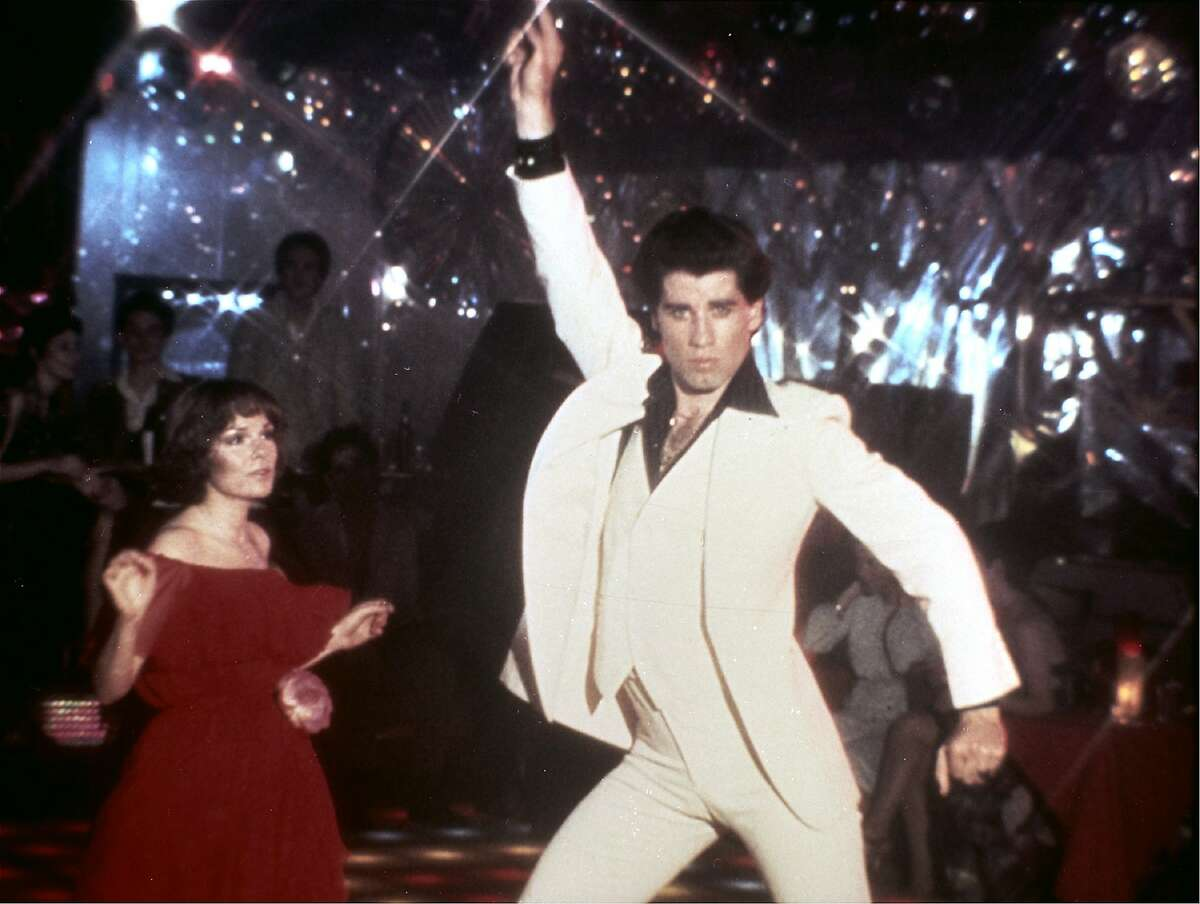 """** FILE ** In this 1977 file photo originally released by Paramount Pictures, John Travolta and Karen Lynn Gorney are shown in a scene from, """"Saturday Night Fever."""" Doctors have revived the old disco song """"Stayin' Alive"""" and found that it might actually live up to its name. At 103 beats per minute, the Bee Gees' sung-in-falsetto tune has almost the perfect rhythm to help jump-start a stopped heart. (AP Photo/Paramount Pictures) ** NO SALES **"""
