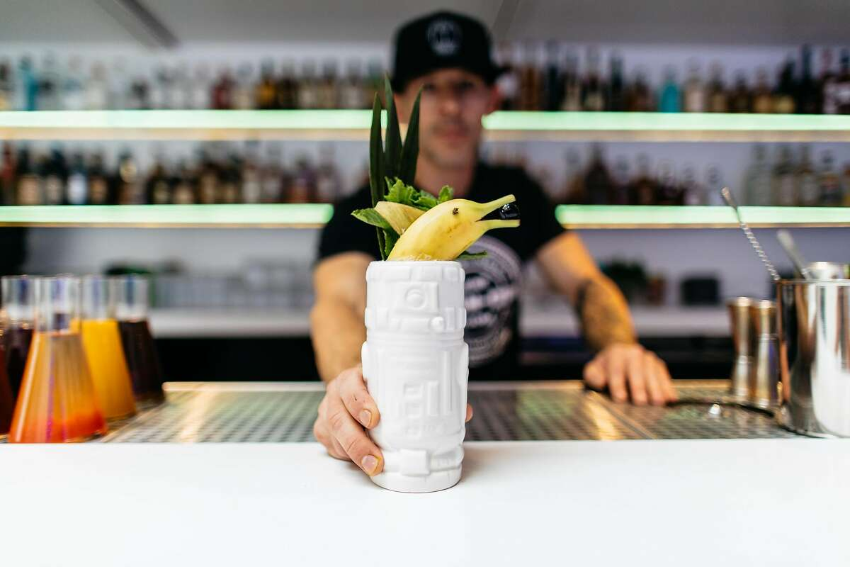 The Grid bar director Jason Huffman offers up the Sing Sling, which is served in a Star Wars-themed tiki mug. Photo credit: Luke Beard