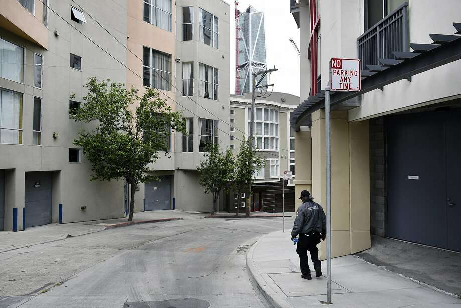 Robert Walker with the Rincon Hill Community Benefit District, picks up trash as he walks through the soon to be renamed East Cut neighborhood, in San Francisco on Thursday May 25, 2017. Photo: Michael Short, Special To The Chronicle
