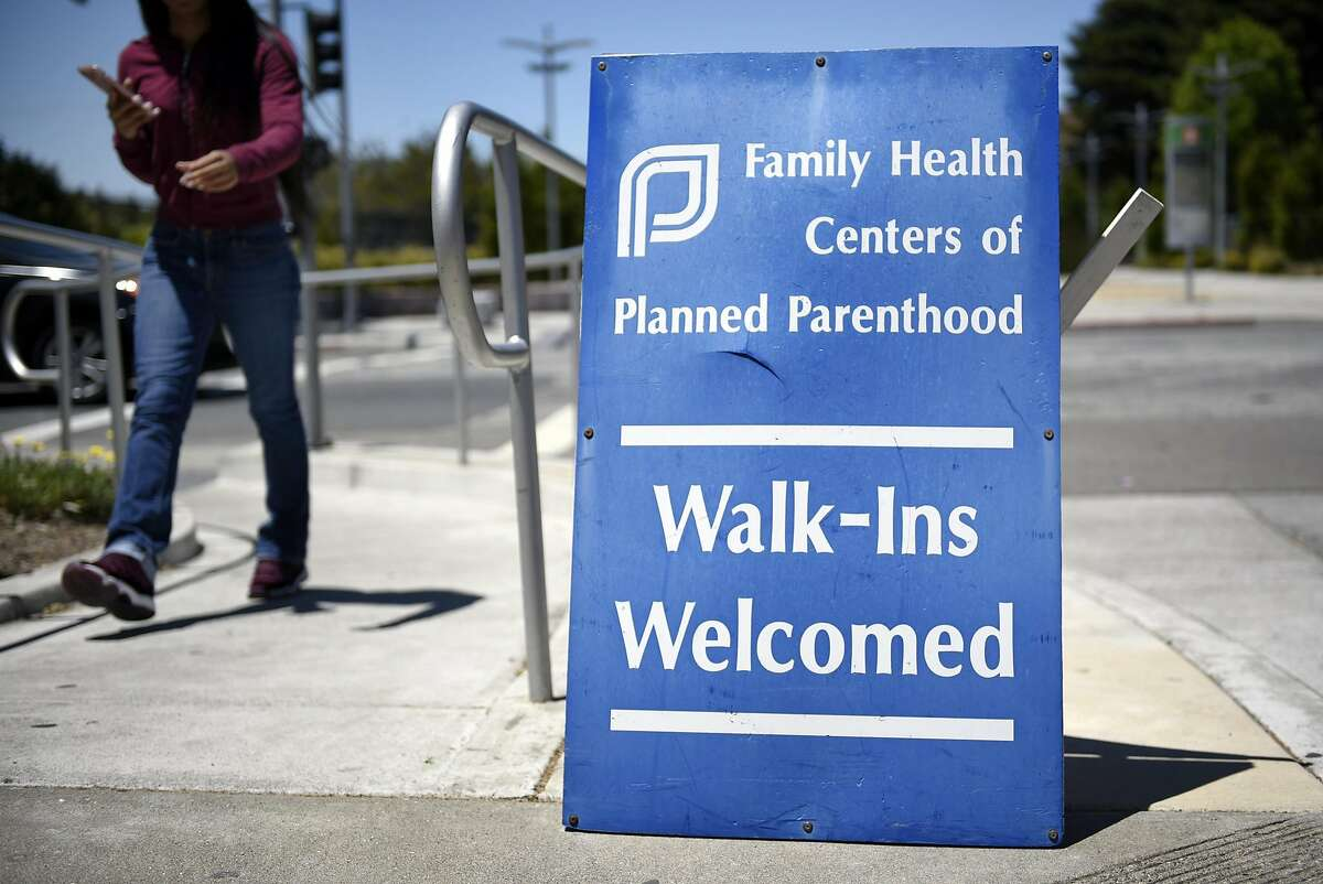 A person walks past a sign outside a Planned Parenthood office on Marina Way in Richmond, CA, on Wednesday May 31, 2017.