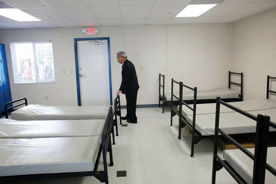 Mayor Ed Lee looks over a room filled with beds as he tours the Dogpatch Navigation Center on Wednesday, May 24, 2017 in San Francisco, Calif. The center will have 64 beds available  for people experiencing chronic homelessness who were previously living in encampments. Photo: Lea Suzuki, The Chronicle