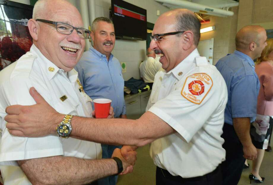Wilton's Deputy Fire Chief Mark Amatrudo congratulates Norwalk Fire Chief Laurence Reilly on his retirement during a ceremony at fire headquarters on Wednesday May 31, 2017 in Norwalk Conn. Reilly is retiring from the department after 42 years of service to the department Photo: Alex Von Kleydorff / Hearst Connecticut Media / Norwalk Hour