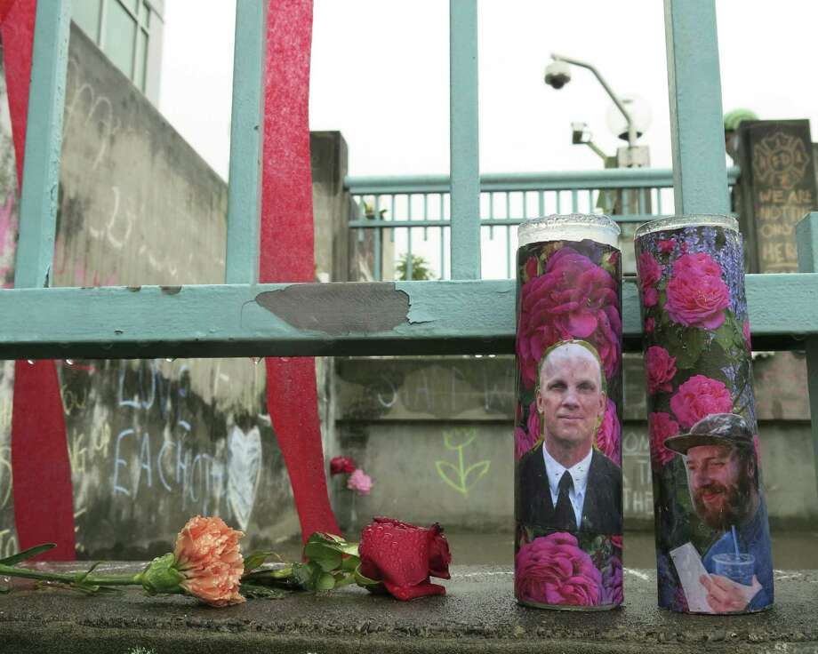 Votive candles bearing the photos of two men who were fatally stabbed on a Portland, Ore., light-train while trying to stop another man from harassing two young women with an anti-Muslim tirade, sit on a rain-soaked memorial on Tuesday, May 30, 2107 in Portland. Taliesin Myrddin Namkai-Meche, 23, and Ricky Best, 53, died in the attack. The suspect, Jeremy Joseph Christian, 35, made a first court appearance on charges of aggravated murder and attempted murder Tuesday in a Portland, Oregon courthouse. (AP Photo/Gillian Flaccus) Photo: Gillian Flaccus, STF / Associated Press / Copyright 2017 The Associated Press. All rights reserved.