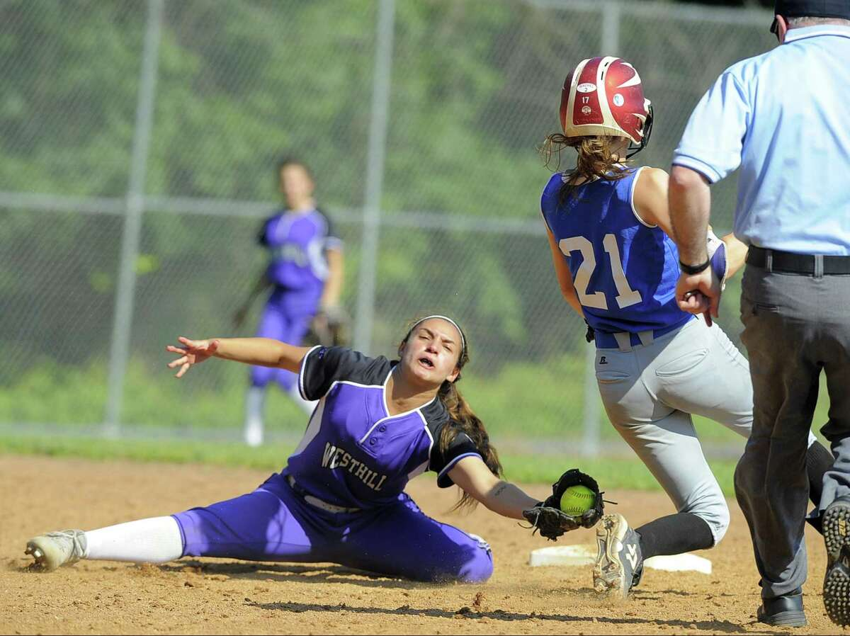 Glastonbury Julia Karnes avoids the tag from Westhill Gabby Laccona on a thrid innigs stolen base in a second round CIAC Class LL softball game at Westhill High School in Stamford, Conn. on Tuesday, May 31, 2017. Westhill defeated Glastonbury 3-2.
