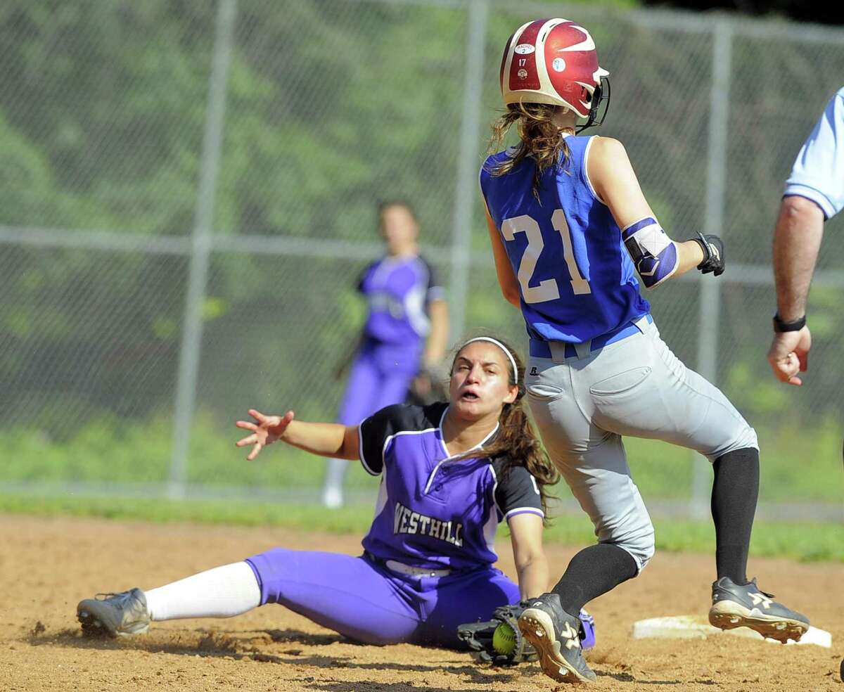 Westhill Gabby Laccona looks to tag out Glastonbury Julia Karnes on a third inning stolen base in a second round CIAC Class LL softball game at Westhill High School in Stamford, Conn. on Tuesday, May 31, 2017. Karnes was called safe on the play and later scored a run.