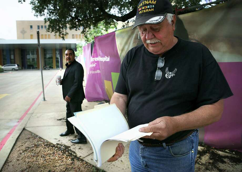 Various descendants of San Antonio's first families, including Raymond Hernandez, right, and Ramon Vasquez, left, arrive at the hospital on Wednesday, May 31, 2017, for a meeting with officials from the hospital.  Many members of the city's first families were interred at a campo santo and larger Catholic cemetery underneath Children's Hospital of San Antonio. Photo: Bob Owen, Staff / San Antonio Express-News / ©2017 San Antonio Express-News