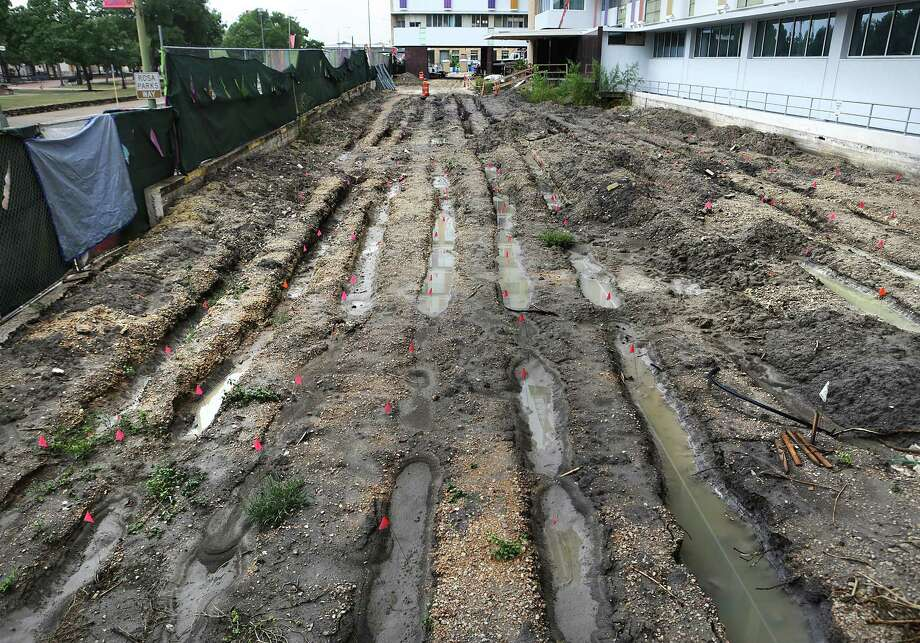 Rainwater at the end of May filled holes dug where bones have been found at the Children's Hospital of San Antonio. Photo: Bob Owen /San Antonio Express-News / ©2017 San Antonio Express-News