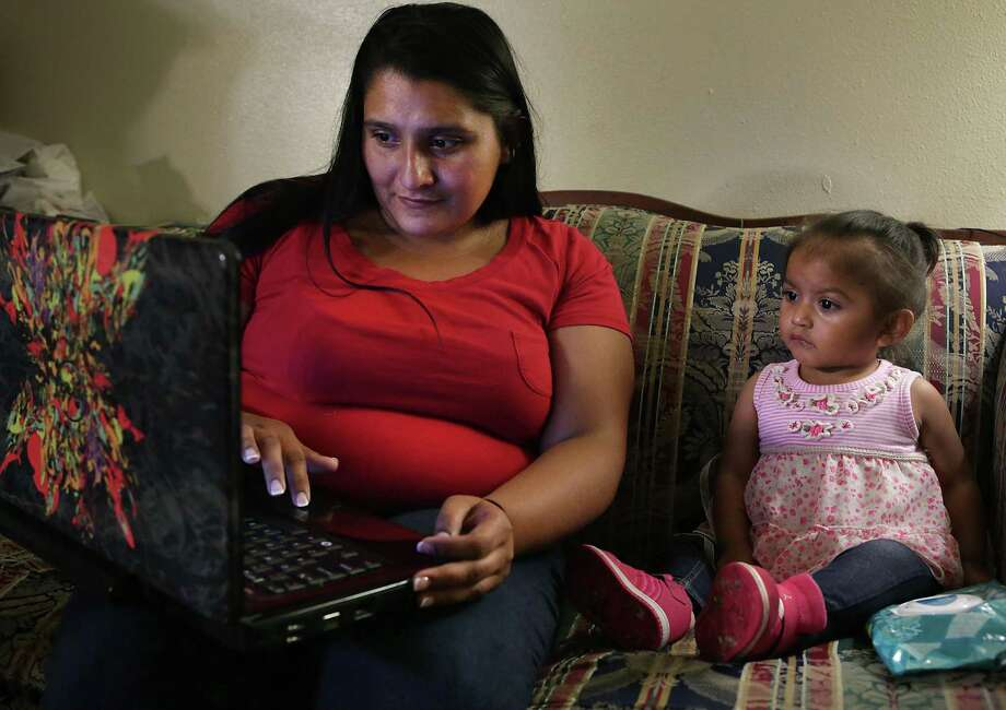 Yolanda Aldana, 27, a former addict and mother of three, sits with her 1-year-old daughter Nevaeh Aldana on Monday, May 22, 2017, in her apartment watching a children's video before taking her to childcare. Photo: Bob Owen, Staff / San Antonio Express-News / ©2017 San Antonio Express-News