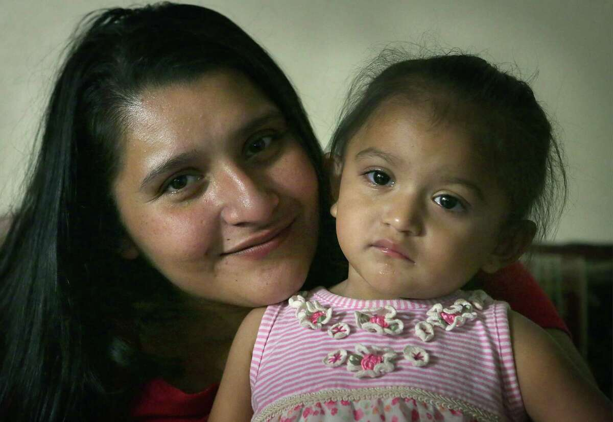 Yolanda Aldana, 27, a former addict and mother of three, sits with her 1-year-old daughter Nevaeh Aldana on Monday, May 22, 2017, in her apartment before taking her to childcare.