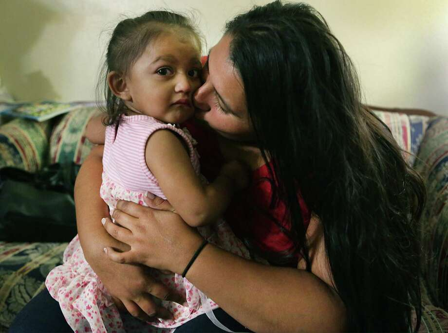 Yolanda Aldana, 27, a former addict and mother of three, sits with 1-year-old daughter Nevaeh last month. Aldana, who has been clean for two years, is working to help expectant moms with drug addictions. Such outreach — instead of punitive policies — better serve women at risk of giving birth to addicted babies. Photo: Bob Owen / San Antonio Express-News / ©2017 San Antonio Express-News