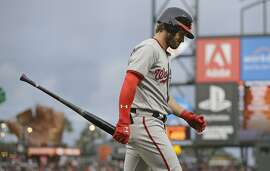 Washington Nationals' Bryce Harper walks back to the dugout after striking out looking against San Francisco Giants starting pitcher Jeff Samardzija in the second inning of a baseball game Tuesday, May 30, 2017, in San Francisco. (AP Photo/Eric Risberg)