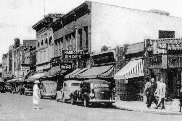 """The face of downtown New Milford has evolved over the years, though much of its charm and character has remained the same. Numerous tenants have come and gone at the corner of Main and Bank streets. Above, circa 1930s, is one of the businesses that occupied that space, Park Pharmacy. It is flanked by Markoff's show store. In more recent years, Slone Pharmacy operated out of the space at the intersection. Robertson Jewelers is the anchor store today. If you have a photograph you'd like to share for """"Way Back When,"""" contact Deborah Rose at drose@newstimes.com or 860-355-7324."""
