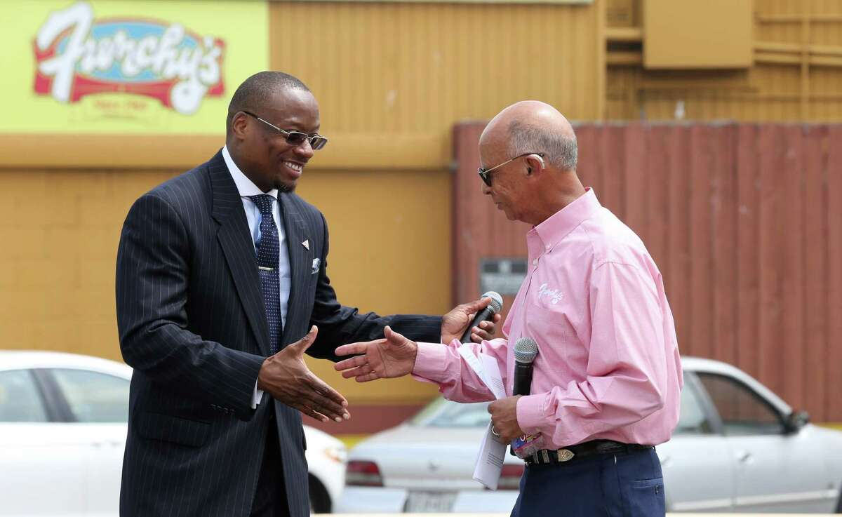 Wheeler Avenue Baptist Church Rev. Dr. Marcus D. Cosby, left, and Frenchy's Chicken owner Percy Creuzot, right, announce the restaurant moving to the intersection of Scott and Alabama streets, and the church expanding its blueprint to where Frenchy's currently stands Wednesday, May 31, 2017, in Houston.