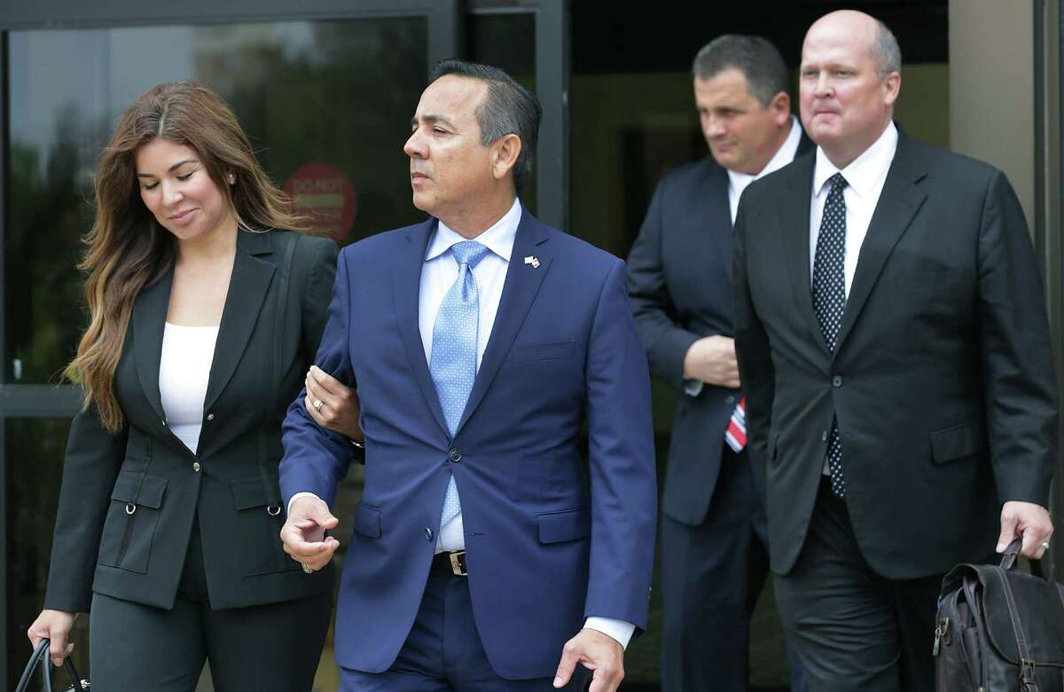 Sen. Carlos Uresti walks out of the federal courthouse in San Antonio with his wife, Lleanna, in May.Uresti is facing 11 felony charges, including wire and securities fraud, conspiracy, and acting as unregistered securities broker in connection with his involvement in a now-defunct oil field services company, FourWinds Logistics.