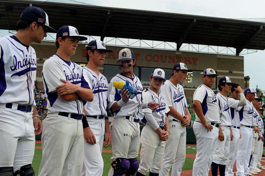 Port Neches-Groves players pass a good luck stuffed alligator before playing against Brenham in the Class 5A-3 baseball regional final at Sam Houston State's Don Sanders Stadium on Wednesday evening.  Photo taken Wednesday 5/31/17 Ryan Pelham/The Enterprise Photo: Ryan Pelham / ©2017 The Beaumont Enterprise/Ryan Pelham
