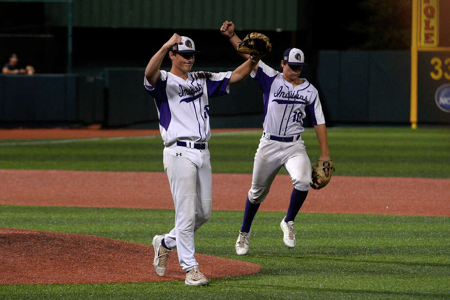 Port Neches-Groves pitcher Brandon Morse, left, and third baseman Austin Bost celebrate after beating Brenham in the first game of the Class 5A-3 baseball regional final at Sam Houston State's Don Sanders Stadium on Wednesday evening.  Photo taken Wednesday 5/31/17 Ryan Pelham/The Enterprise Photo: Ryan Pelham / ©2017 The Beaumont Enterprise/Ryan Pelham