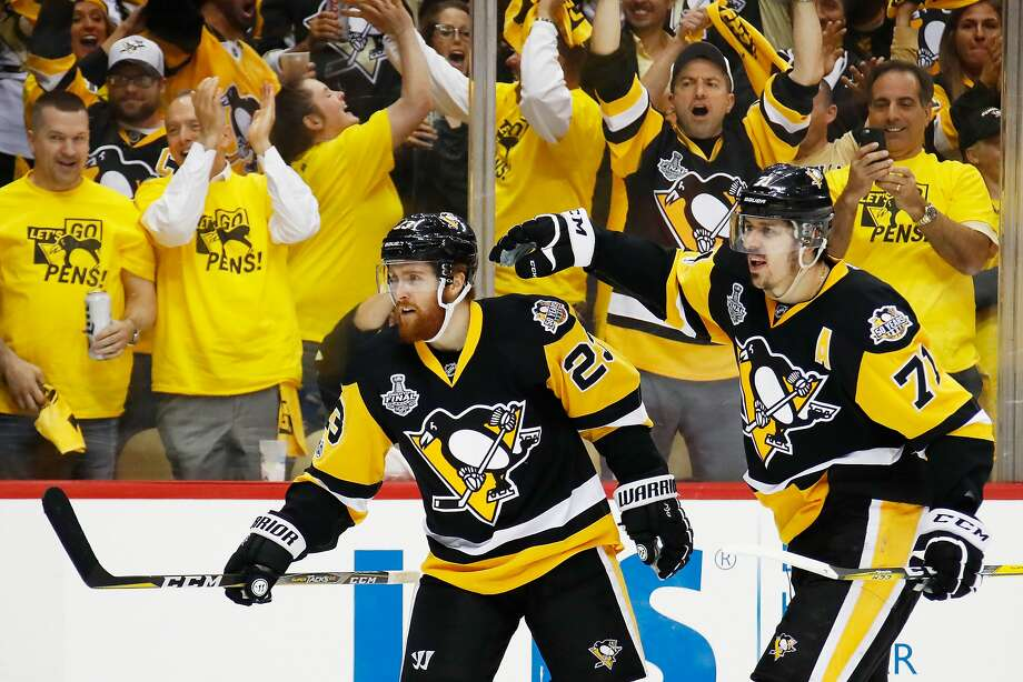 PITTSBURGH, PA - MAY 31:  Scott Wilson #23 of the Pittsburgh Penguins celebrates with Evgeni Malkin #71 after scoring a goal during the third period in Game Two of the 2017 NHL Stanley Cup Final against the Nashville Predators at PPG Paints Arena on May 31, 2017 in Pittsburgh, Pennsylvania.  (Photo by Gregory Shamus/Getty Images) Photo: Gregory Shamus, Getty Images
