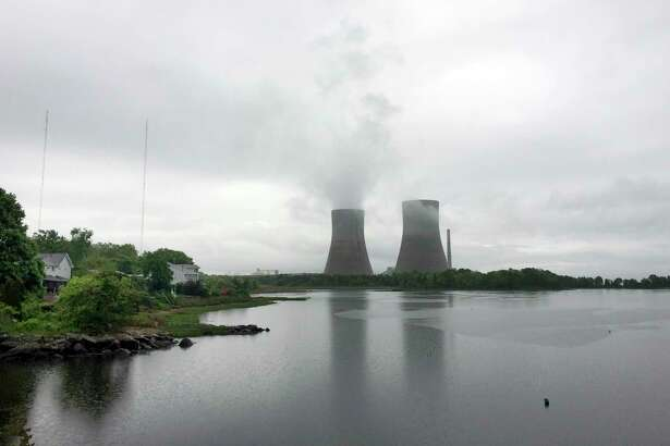 The Brayton Point Power Station, New England's largest and one of its last coal-fired power plants, appears on a cloudy day, Wednesday, May 31, 2017, in Somerset, Mass. The plant, which has been generating electricity since the 1960s along Mount Hope Bay, is shutting down permanently. It's been cited by federal regulators as one of the region's heaviest polluters. (AP Photo/Matt O'Brien)