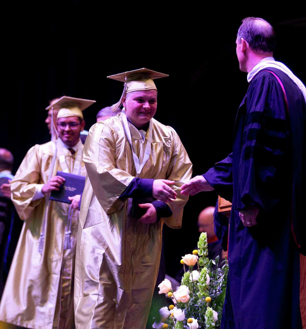 Seniors receive their high school diplomas during a Conroe High School graduation ceremony at Cynthia Woods Mitchell Pavilion, Tuesday, May 30, 2017, in The Woodlands.